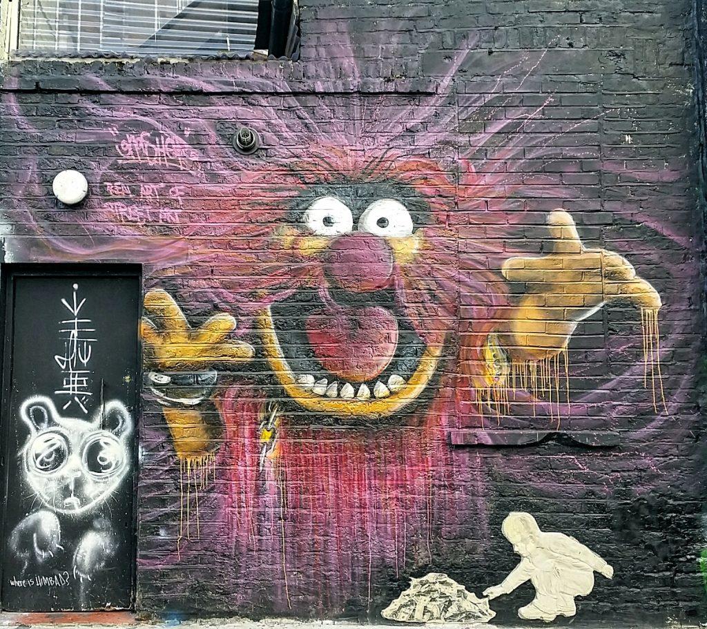 Scary subject in street art piece in Camden